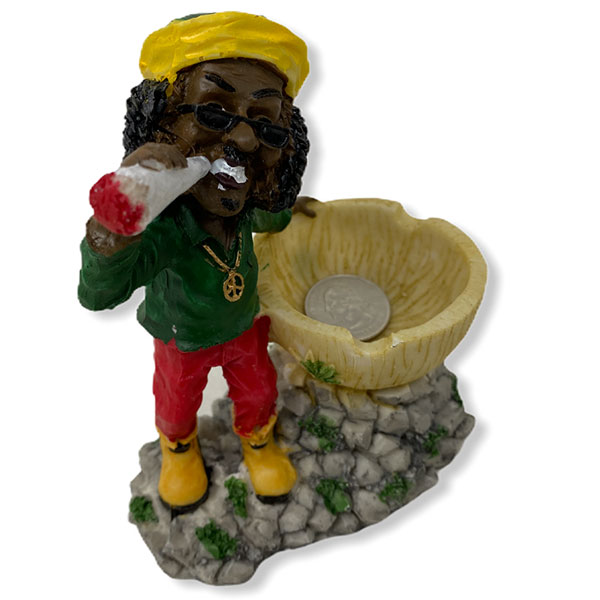 Rasta Man Chilling And Standing In Front Of Astray Bowl While Smoking