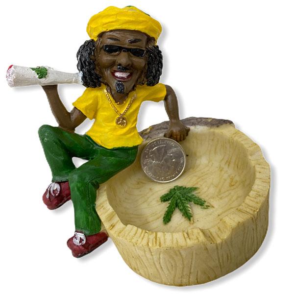 Rasta Man Chilling On Top Of A Ashtray Bowl While Smoking