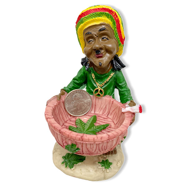 Rasta Man Holding Astray Bwol With His Hands While Smiling